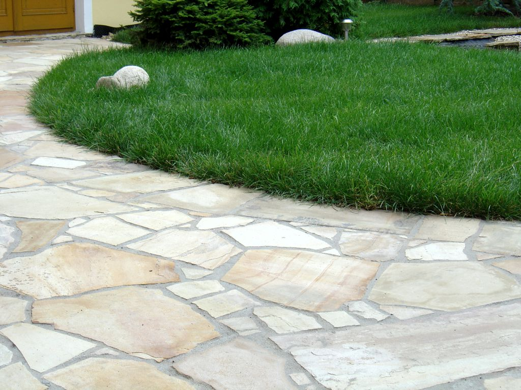 Stone paving laid in a concrete bed