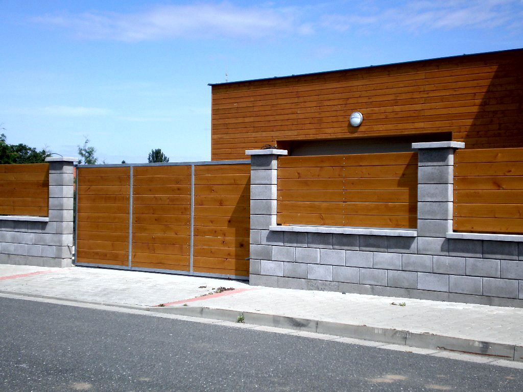 Prefabricated fence elements with wooden infill