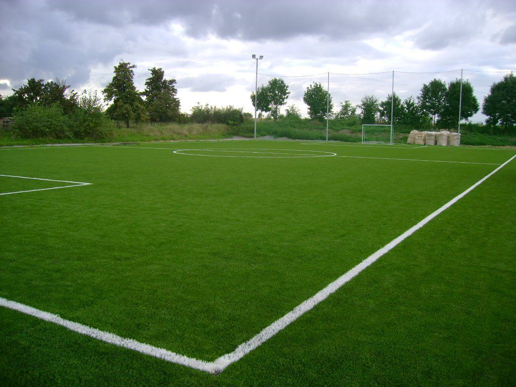 Artificial turf on a football field with permanent lines