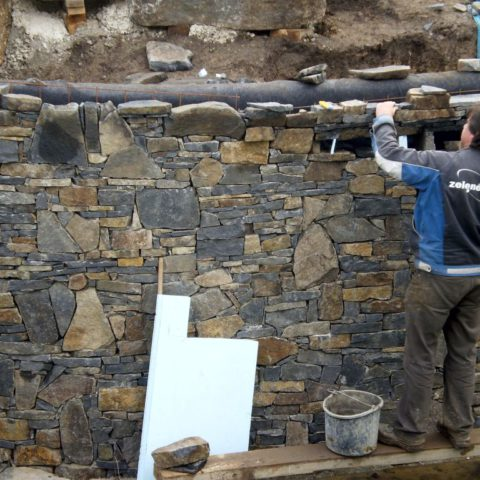 Solution of the natural wall of the bathing pond made of basalt