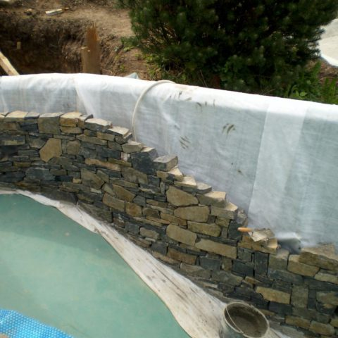 Working with stone inside the bathing area of the Biotope