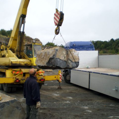 Loading basalt stones in the quarry weighing 3-7 tons