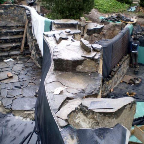 Laying the natural staircase and the bottom of the biotope