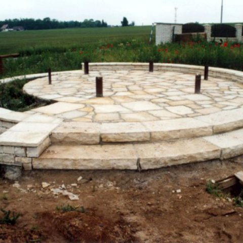 Laying natural stone and stairs under the gazebo